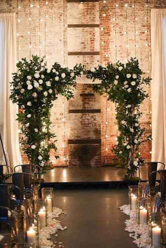 wedding venue decorated with seasonal flowers and lights